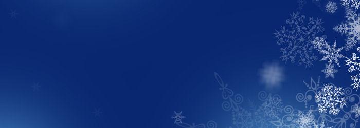 Sininen tausta, jossa lumihiutaleita oikeassa laidassa.